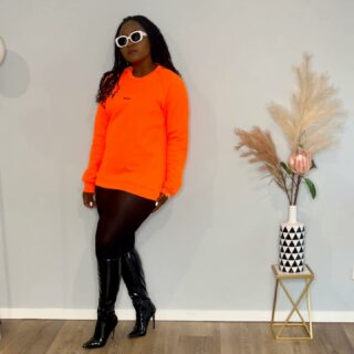 """So excited to be part of @ownsitbyanna """"LIGHT IT UP""""  Neon Sweater Range which drops TONIGHT at 8pm in honour of her dearly departed brother Thomas.   I am wearing the neon orange (FIERCE) which Anna has affectionately named THOMAS and the neon pink (FEMININE) named TOMMY and neon yellow (FUN) named TOM. So which one are you? They are 100% Australian made.  A portion of sales from this collection will be donated to @saneaustralia A national mental health charity supporting the five million Australians affected by complex mental health issues."""