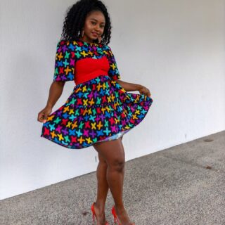 Friday has asked me to bring you some colours to help you get through this week🤗😆. How fun is this @littlepartydress Isadora criss cross dress. This cutie is cotton and i love the puff sleeves and it has hidden pockets too.  So many colours on this dress I couldn't X out which heels go best with this dress. So are you team BLUE or team RED.  . . .  #sonishstyle #littlepartydress #colourful #colourfulstyle #colourfulfashion #cutedresses #australianfashion #australianfashionblogger #browngirlswhoblog #brisbaneblogger